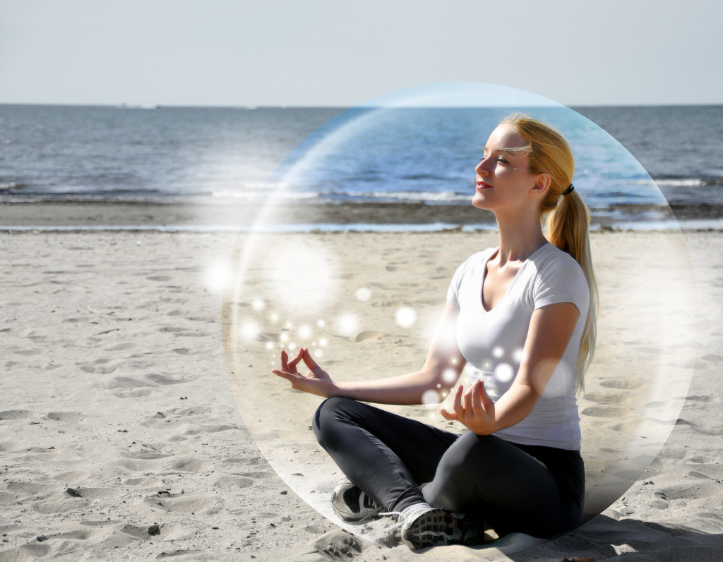 bigstock-Woman-Meditating-On-Beach-In-P-41099062